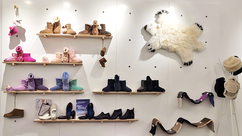 A wall of Glory Wisdom Corp showroom displaying sheepskin shoes